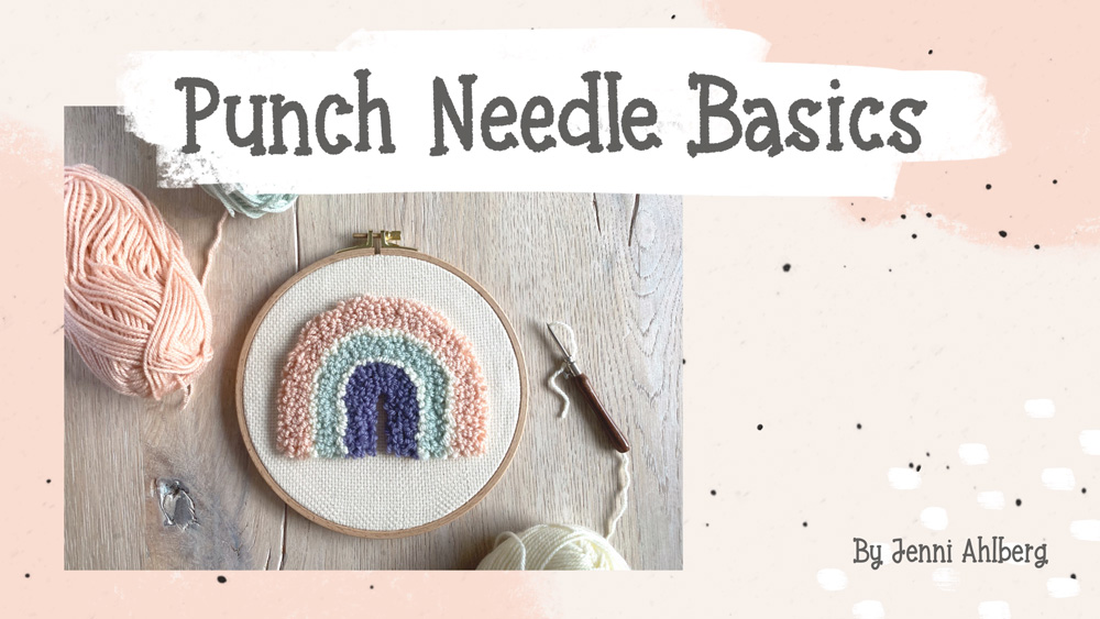 Punch needle embroidery project with a pastel rainbow figure.