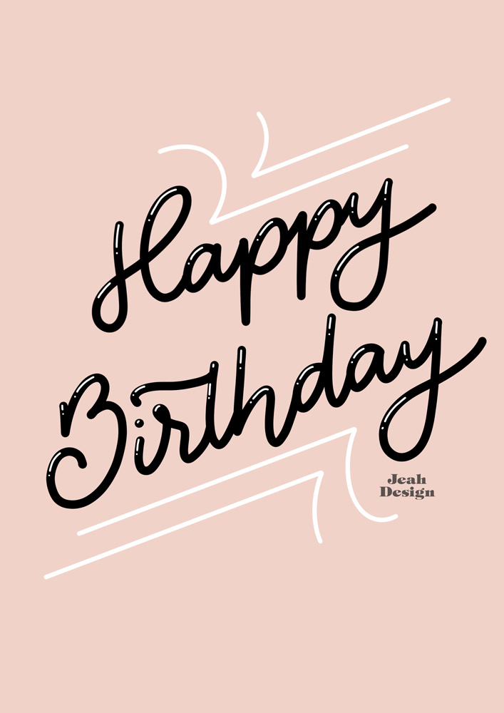 "A pale pink hand-lettered birthday card with ""Happy Birthday"" written in monoline script on it."
